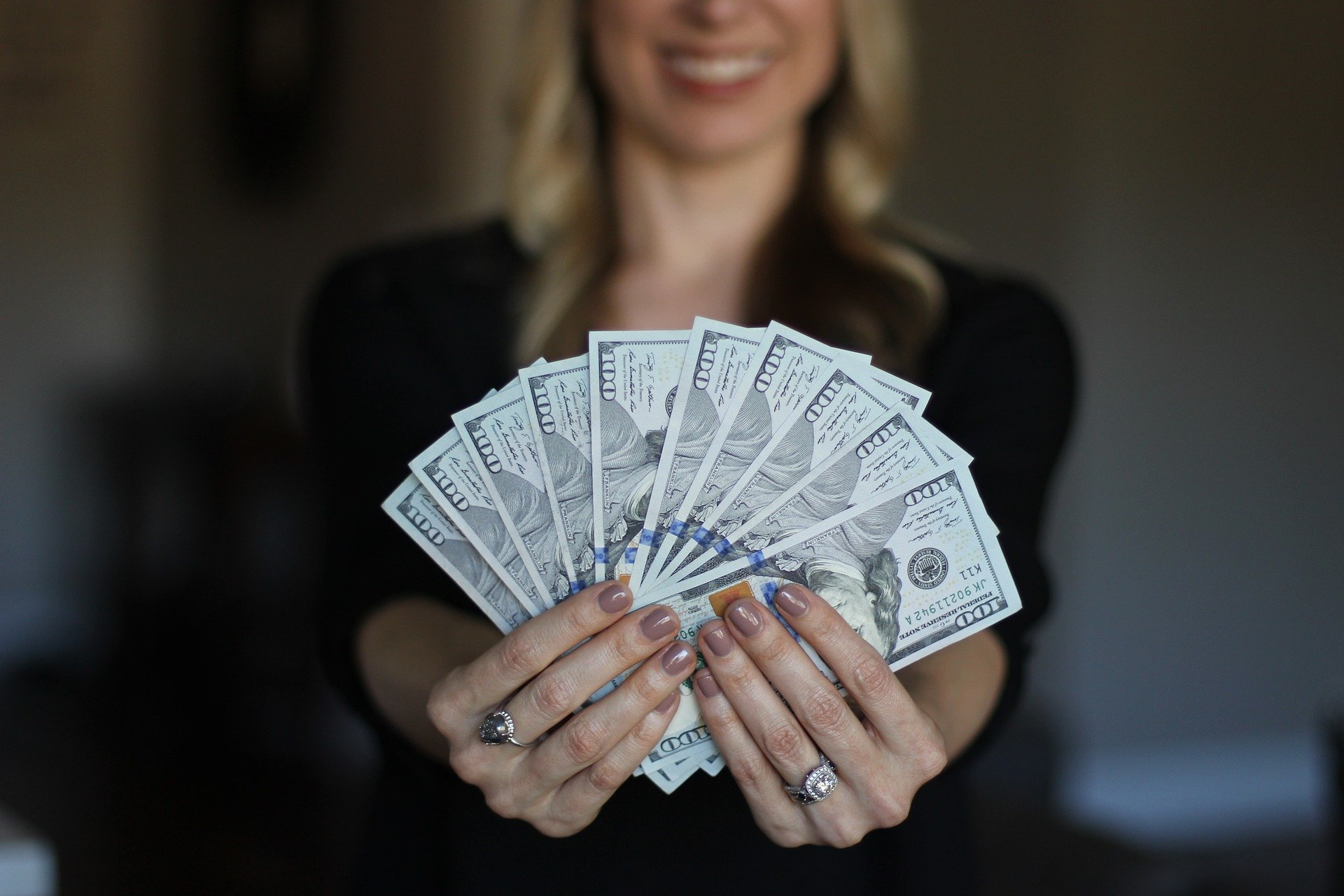 Woman with dollar bills in hands